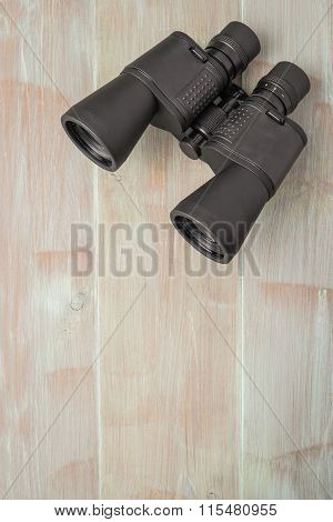 Binoculars On A Natural Blue Wood Surface. Top View With Copy Space.