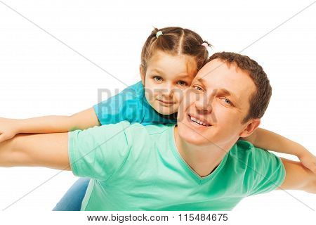 Little pretty girl with  her smiling father