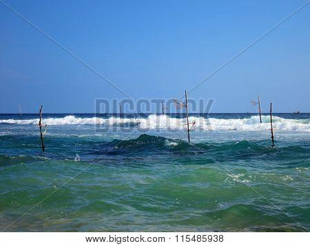 Empty fishermen's sticks in Weligama bay, Sri Lanka