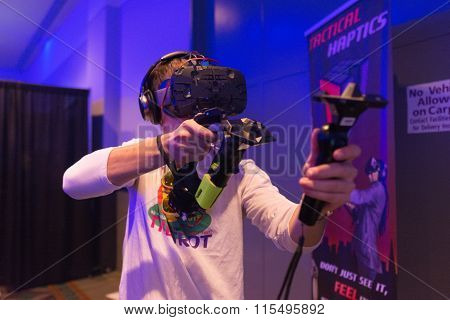 Man Tries Virtual Reality Htc Vive Headset And Hand Controls
