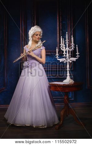 Attractive Young Female Flautist Wearing Baroque Dress