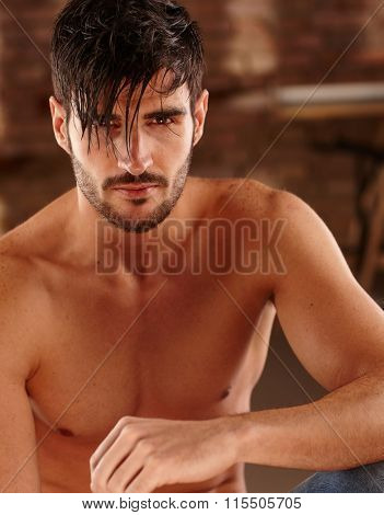 Closeup photo of goodlooking young man with bare chest.