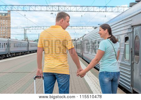 young married couple embarks on a journey on the train poster