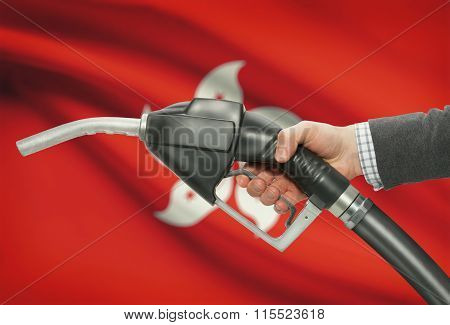 Fuel Pump Nozzle In Hand With National Flag On Background - Hong Kong