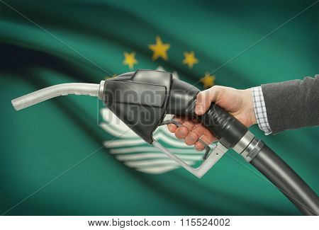 Fuel Pump Nozzle In Hand With National Flag On Background - Macau