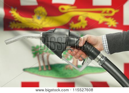 Fuel Pump Nozzle In Hand With Canadian Provinces Flags On Background - Prince Edward Island
