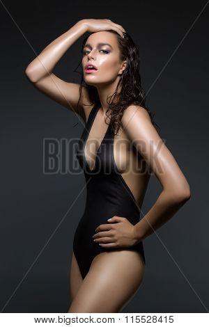 Beautiful girl in black swimwear