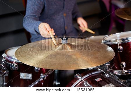 Drummer Striking Cymbal With Drumstick