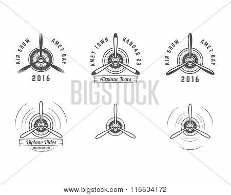 Set of Vintage airplane propeller emblems. Biplane labels. Retro Plane badges,design elements. Aviat