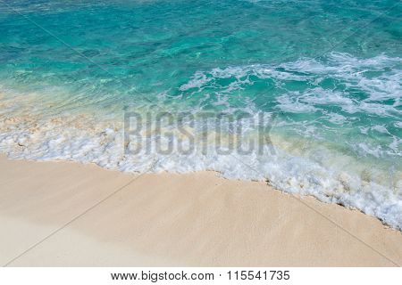 Soft Wave Of The Turquoise Sea On The Sandy Beach. Natural Summer Background. Playa Del Carmen, Mexi