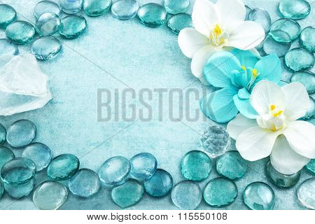 Blue Glass Drops Aqua With White Flowers Orchid And Bar Of Sea Salt Background