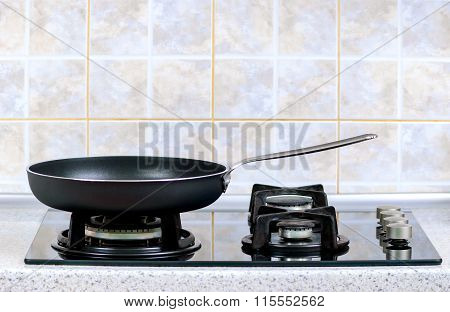 frying pan on the gas stove