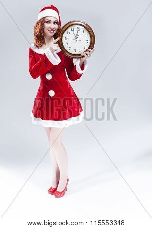 Time And Christmas Holiday Concept. Full Length Portrait Of Smiling Red-haired Santa Helper