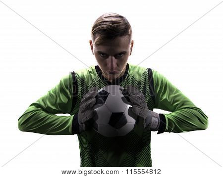 Goalkeeper in green ready to save on white background