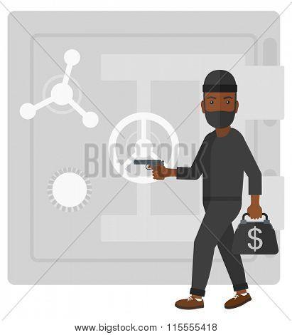 Robber with gun near safe.