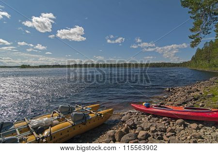 Sport Catamaran And Kayak On The Bank Of The River Reach.