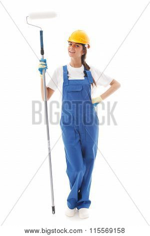 Young beautiful handywoman with paint roller isolated on white
