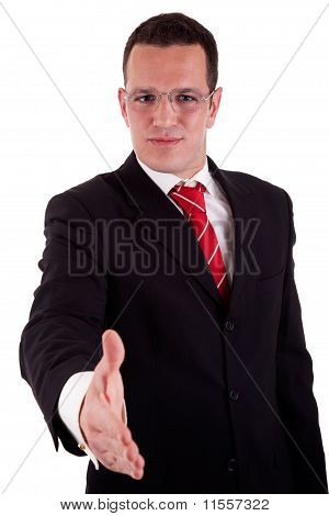 Handsome Business Man, With The Arm Extended For A Handshake, Isolated On White, Studio Shot