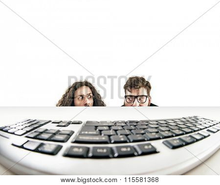 Two nerds starring at keyboard