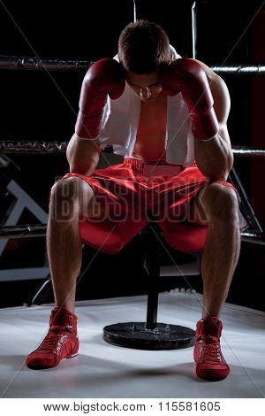 Professional young boxer is expressing negative emotions