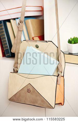 Fashion female handbag with books hanging on case