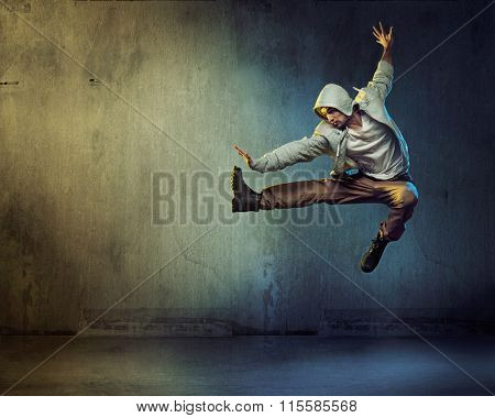 Sporty hip-hop dancer jumping