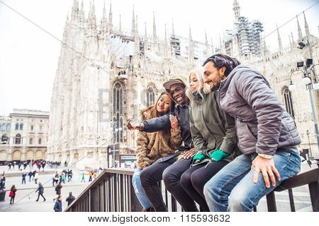 Multiracial Group Of Friends Taking Selfie In Milan