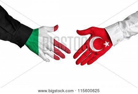 Italy and Turkey leaders shaking hands on a deal agreement
