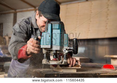 Carpenter workpiece milling machine in the carpentry workshop.