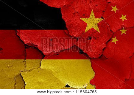 Flags Of Germany And China Painted On Cracked Wall