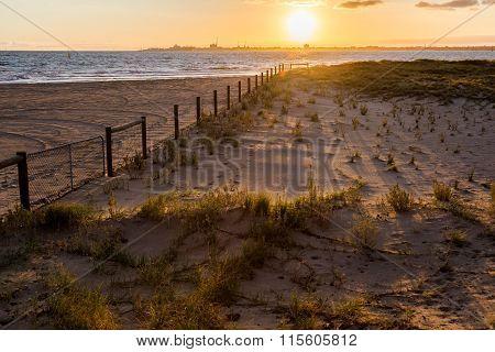 Sunset Casting Shadows On Beach`