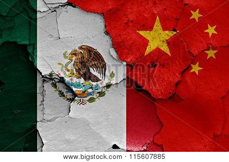 Flags Of Mexico And China Painted On Cracked Wall