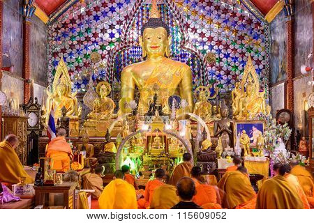 CHIANG MAI, THAILAND - OCTOBER 13, 2015: Buddhist monks perform meditation rituals during evening prayers at Wat Phra That Doi Suthep, a temple on Doi Suthep mountain near the city of Chiang Mai.