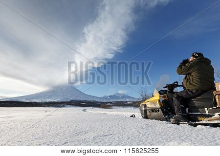 Tourist Photographs Eruption Volcano Sitting On A Snowmobile