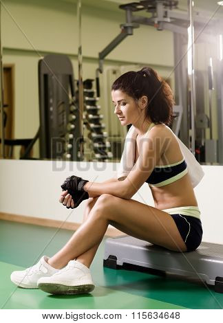 Young Woman Tired After Training In Fitness Club