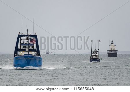 Fishing Boats Heading For Shelter