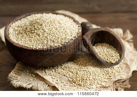 White Quinoa In A Bowl With A Wooden Spoon