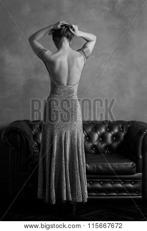 Woman In Evening Dress With Open Back