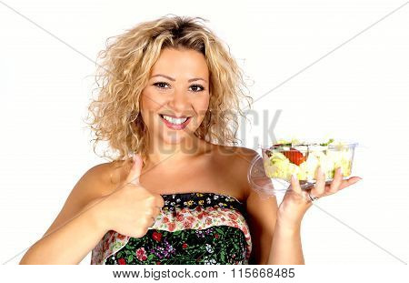 portrait of a attractive smiling woman eating salat