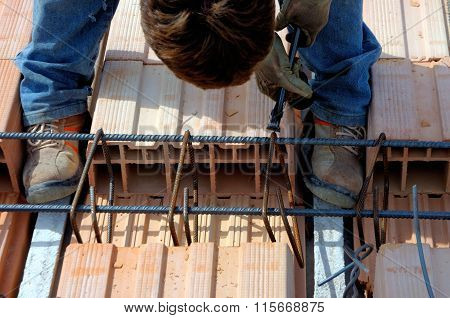 Worker or ironworker working on concrete reinforcements