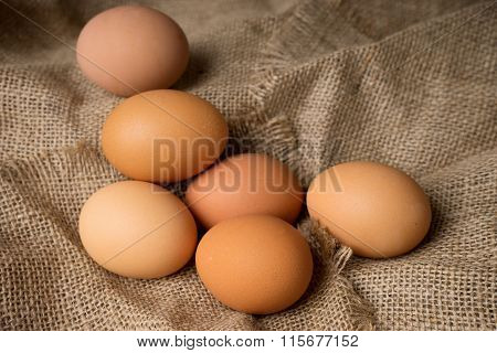 Egg On Burlap Material Background