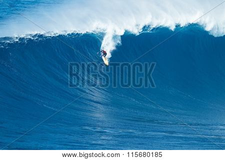 MAUI, HI - JANUARY 16 2016: Professional surfer Albee Layer rides a giant wave at the legendary big wave surf break known as