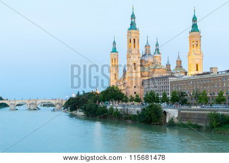 Our Lady of the Pillar Basilica with Ebro River at dusk Zaragoza, Spain poster