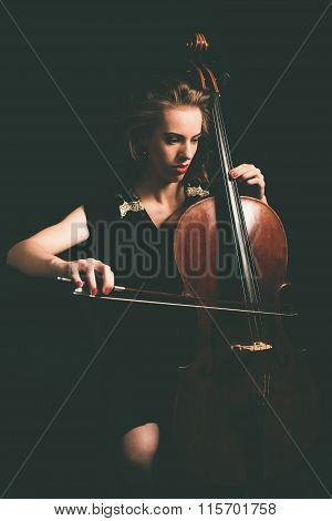 Young Female Cellist Playing Cello Instrument