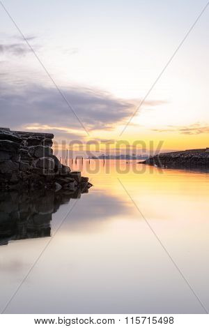 Calm Harbor At Sunset