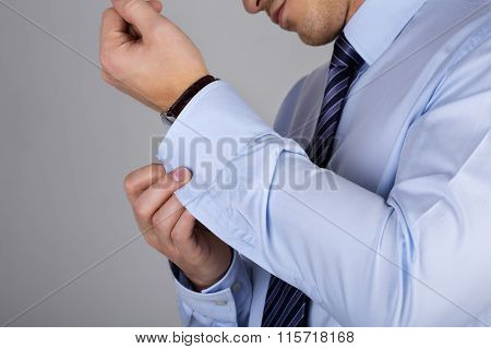 Man Fastens His Cuff Links Close-up