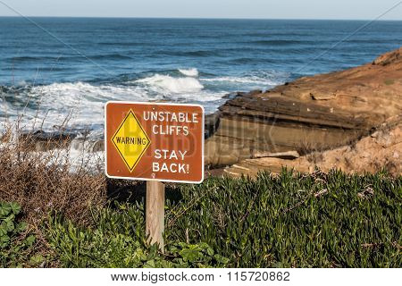 Danger Sign with Cliffs in Background at Sunset Cliffs
