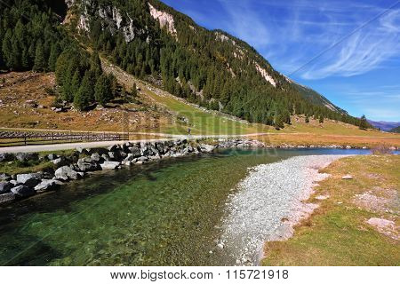 Headwaters of the famous Krimml waterfalls. The crystal clear transparent water glows in the midday sun. Austrian Alps