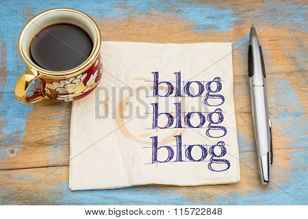 blog, blog, blog - blogging concept on a napkin with cup of espresso coffee