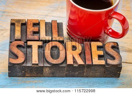 tell stories word abstract - text in vintage letterpress wood type with a cup of coffee - storytelling concept poster